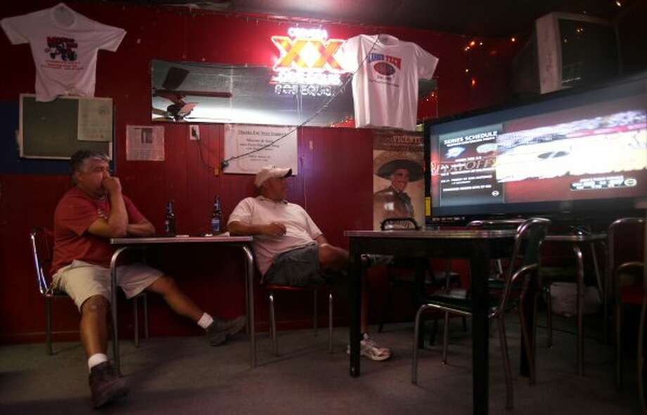(From left) Raul Mendez and Robert Lopez anxiously watch the Spurs game against the Oklahoma City Thunder Monday, June 4, 2012, at Tony's. Lopez said they like the atmosphere, people and food at the bar. (SAN ANTONIO EXPRESS-NEWS)