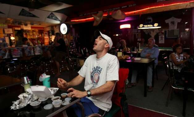 "James Kollaja cheers as Manu Ginobili scores during the Spurs game against the Oklahoma City Thunder Monday, June 4, 2012, at Tony's. Kollaja stumbled upon the bar last week after a game and considers Tony's, ""a true San Antonio experience."" (SAN ANTONIO EXPRESS-NEWS)"