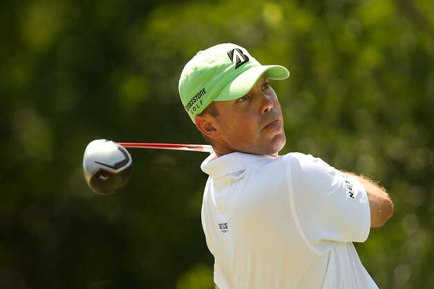 IRVING, TX - MAY 19: Matt Kuchar of the U.S. plays a tee shot at the 12th hole during the third round of the HP Byron Nelson Championship at TPC Four Seasons Resort on May 19, 2012 in Irving, Texas. (Photo by Darren Carroll/Getty Images) Photo: Darren Carroll, Getty Images