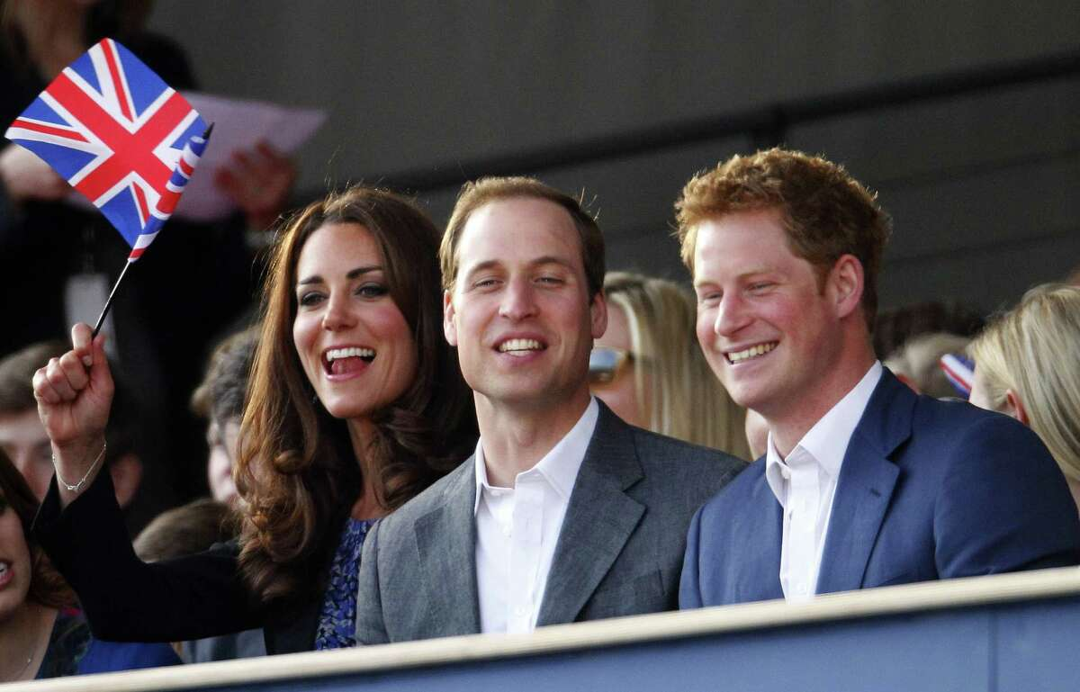 TOPSHOTS (L-R) Princess Beatrice of York, Catherine, Duchess of Cambridge, Princes William and Harry attend The Diamond Jubilee Concert outside Buckingham Palace in London, on June 4, 20112. A chain of more than 4,200 beacons began to flare across the globe Monday to mark Queen Elizabeth II's diamond jubilee, with the last to be lit by the monarch at a star-studded concert at Buckingham Palace. AFP PHOTO / Anthony Devlin /POOLDave Thompson/AFP/GettyImages