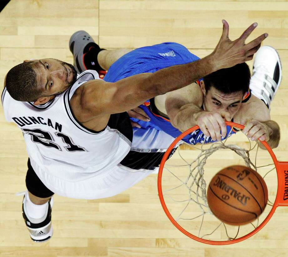 Oklahoma City Thunder power forward Nick Collison (4) dunks against San Antonio Spurs center Tim Duncan during the first half of Game 5 in the NBA basketball Western Conference finals, Monday, June 4, 2012 in San Antonio. The Thunder won to take a 3-2 series lead. (AP Photo/Eric Gay) Photo: Eric Gay, Associated Press / AP