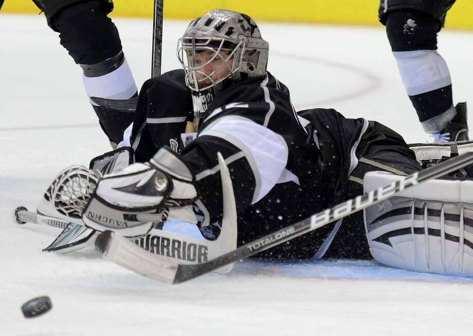 Los Angeles Kings goalie Jonathan Quick (32) makes a save in the third period against the New Jersey Devils during Game 3 of the Stanley Cup Finals, Monday, June 4, 2012, in Los Angeles.  The Kings won 4-0. (AP Photo/Mark J. Terrill) Photo: Mark J. Terrill, Associated Press / AP