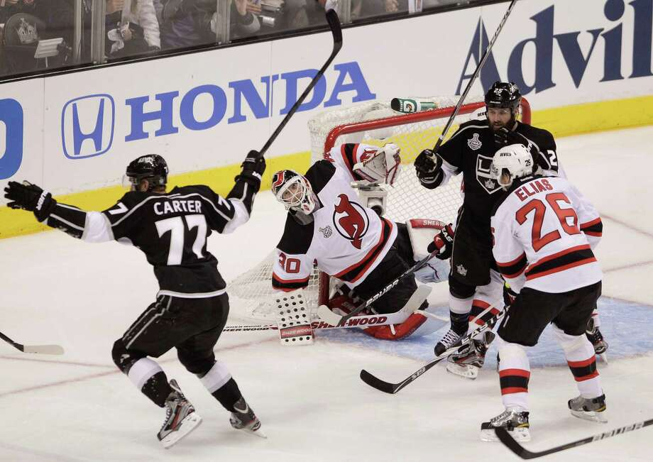 New Jersey Devils goalie Martin Brodeur (30) reacts as Los Angeles Kings center Jeff Carter (77) celebrates a third-period goal during Game 3 of the NHL Stanley Cup Finals, Monday, June 4, 2012, in Los Angeles. The Kings won and now have a 3-0 series lead. (AP Photo/Jae C. Hong) Photo: Jae C. Hong, Associated Press / AP