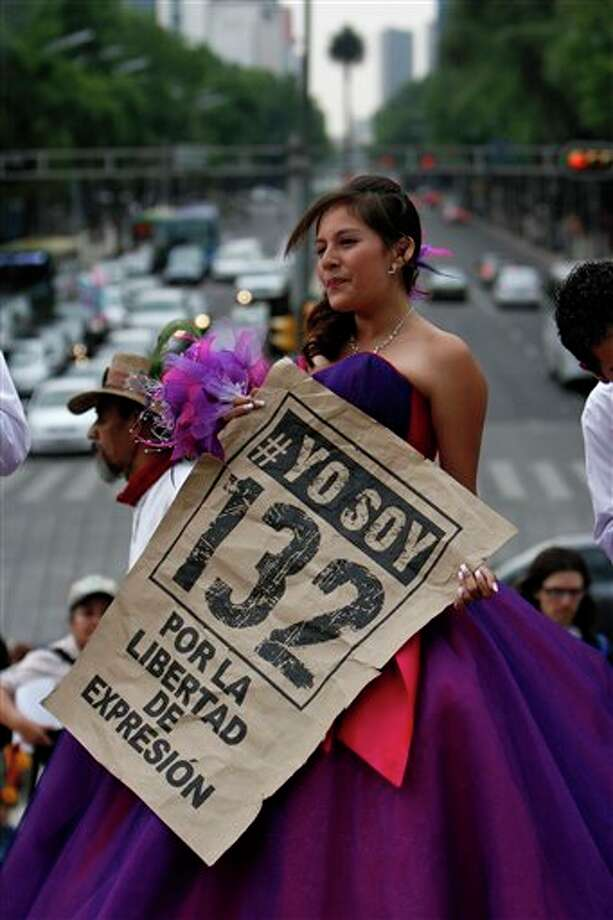 "A 15-year-old girl holds up a sign that reads in Spanish ""#I'm 132 for the freedom of expression"" during a ""Quinceanera"" birthday celebration after a protest in Mexico City, Sunday, June 3, 2012.  #132 is the name of a university movement that rejects the possible return of the Institutional Revolutionary Party (PRI). Mexico will hold presidential elections on July 1. (AP Photo/Marco Ugarte) Photo: Associated Press"