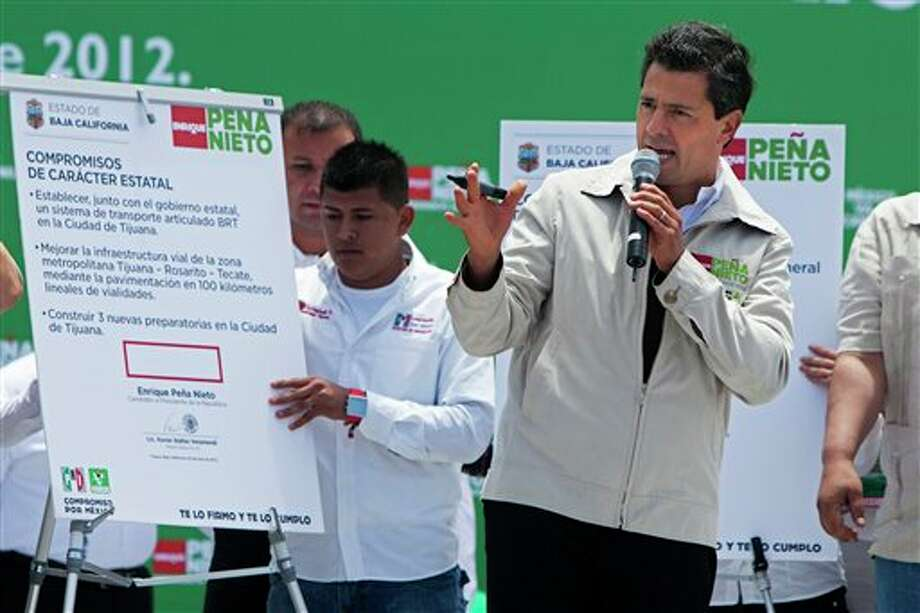 Mexican presidential candidate Enrique Pena Nieto of the Revolutionary Institutional Party (PRI) speaks during a campaign stop in the northern border city of Tijuana, Mexico, Sunday, June 3, 2012. On July 1, Mexico will hold presidential elections. (AP Photo/Alex Cossio) Photo: Associated Press
