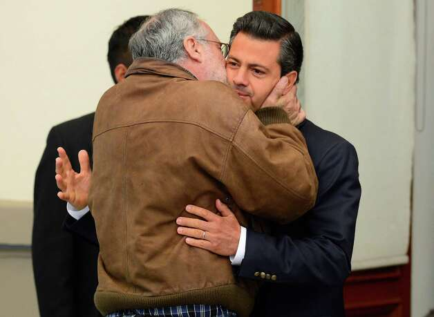Mexican poet Javier Sicilia (L) greets Mexican presidential candidate for the Institutional Revolutionary Party (PRI), Enrique Pena Nieto, during an event he presides in which the four presidential candidates, each at a time, meet with the Movement for Peace with Justice and Dignity, in Mexico City on May 28, 2012. Mexico will hold presidential elections on July 1, 2012.  AFP PHOTO/Alfredo ESTRELLA        (Photo credit should read ALFREDO ESTRELLA/AFP/GettyImages) Photo: ALFREDO ESTRELLA, Getty Images / 2012 AFP
