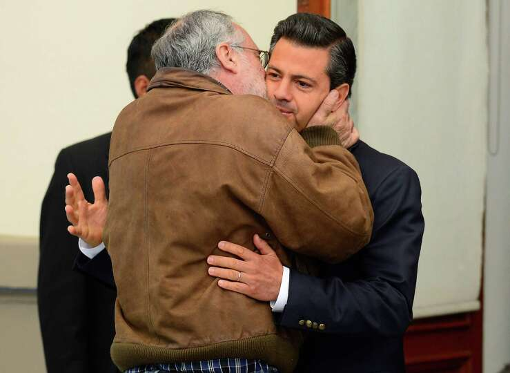 Mexican poet Javier Sicilia (L) greets Mexican presidential candidate for the Institutional Revoluti