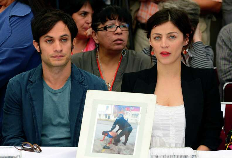 Mexican actors Gael Garcia Bernal (L) and Ilse Salas attend an event presided by Mexican poet Javier