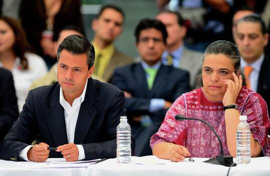 Mexican presidential candidate for the Institutional Revolutionary Party (PRI), Enrique Pena Nieto (L), and Mexico City's mayoral candidate Beatriz Paredes, attend an event presided by Mexican poet Javier Sicilia (out of frame) in which the four presidential candidates, each at a time, meet with the Movement for Peace with Justice and Dignity, in Mexico City on May 28, 2012. Mexico will hold presidential elections on July 1, 2012.  AFP PHOTO/Alfredo ESTRELLA        (Photo credit should read ALFREDO ESTRELLA/AFP/GettyImages) Photo: ALFREDO ESTRELLA, Getty Images / 2012 AFP