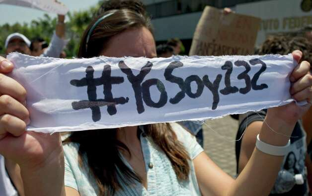 "A Mexican university student, member of the new movement called ""Yo soy 132"" (I Am #132), holds a banner inside the Mexican Electoral Institute offices on May 31, 2012 in Mexico City. The students handed a petition to Electoral authorities, asking for an additional television debate among the four presidential candidates. Mexico will hold presidential elections next July 1st. AFP PHOTO/Omar Torres        (Photo credit should read OMAR TORRES/AFP/GettyImages) Photo: OMAR TORRES, Getty Images / 2012 AFP"