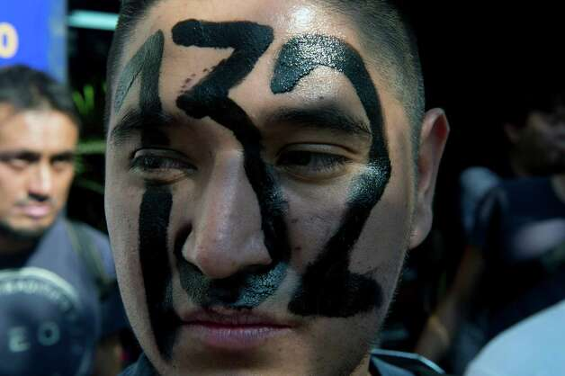 "A Mexican university student, member of the new ""Yo soy 132"" (I am #132) movement, takes part in a demonstration to demand the TV broadcasting of the second debate of the four presidential candidates in the framework of the electoral campaign, in Mexico City on May 28, 2012. Mexico is to hold presidential elections next July 1st.   AFP PHOTO/Yuri CORTEZ        (Photo credit should read YURI CORTEZ/AFP/GettyImages) Photo: YURI CORTEZ, Getty Images / 2012 AFP"