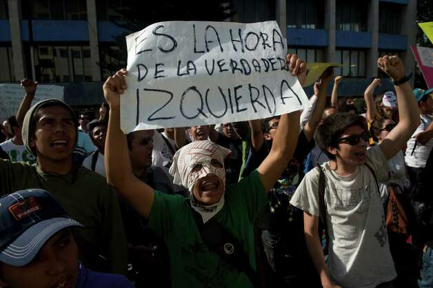 "Mexican university students, members of the new ""Yo soy 132"" (I am #132) movement, shout slogans during a demonstration to demand the national simultaneous broadcast of the second debate of the four presidential candidates in the framework of the electoral campaign, in Mexico City on May 28, 2012. Mexico is to hold presidential elections next July 1st.   AFP PHOTO/Yuri CORTEZ        (Photo credit should read YURI CORTEZ/AFP/GettyImages) Photo: YURI CORTEZ, Getty Images / 2012 AFP"