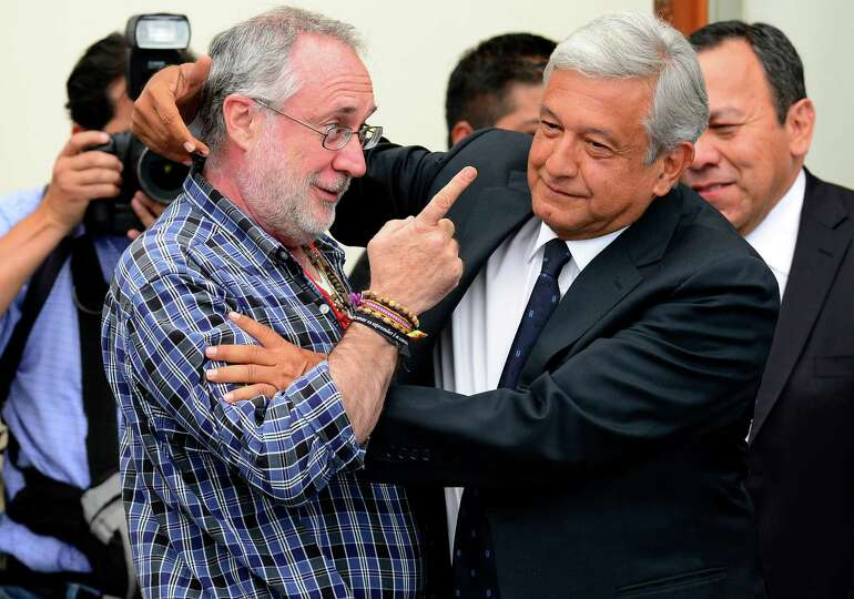 Mexican poet Javier Sicilia (L) shares a joke with Mexican presidential candidate for the leftist co