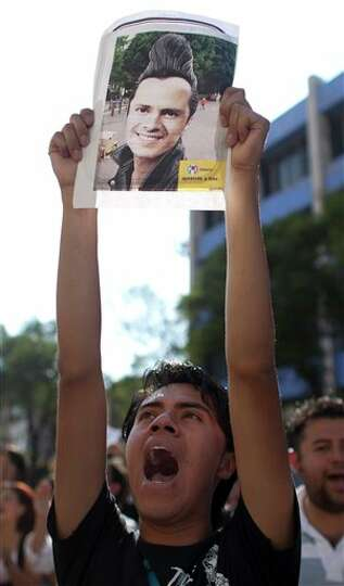 A protester shouts slogans during a protest against a possible return of the old ruling Institutiona