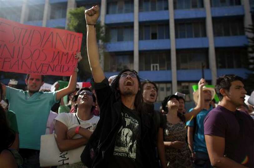 A man shouts slogans during a demonstration against a possible return of the old ruling Institutiona