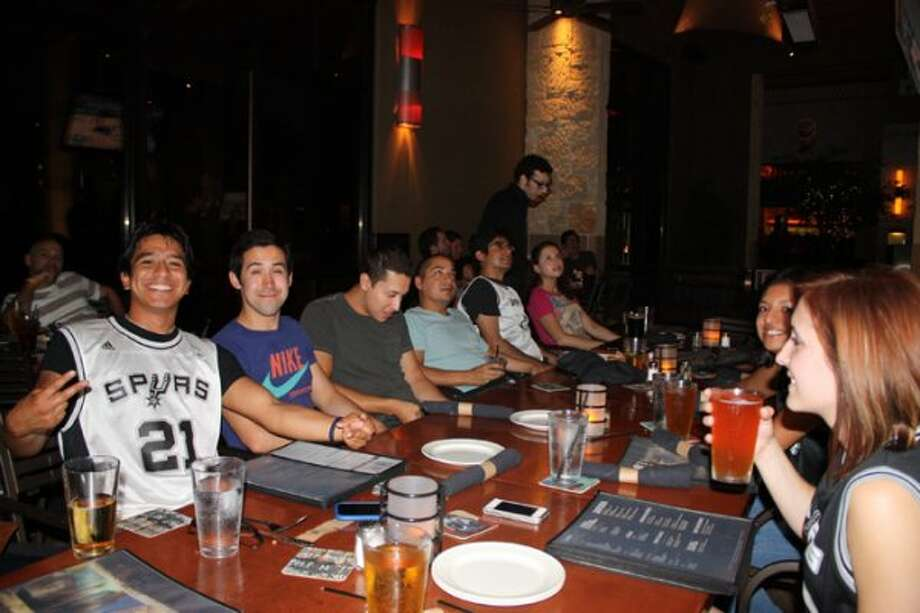 Spurs fans at the Yard House, 15900 La Cantera Parkway, cheer on their team during game five Monday night. (Yvonne Zamora)