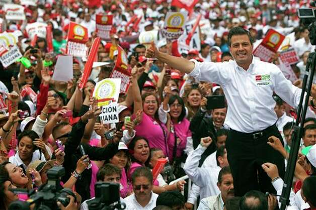 Mexican presidential candidate Enrique Pena Nieto of the Revolutionary Institutional Party (PRI) waves to the crowds during a campaign stop in the northern border city of Tijuana, Mexico, Sunday, June 3, 2012. On July 1 Mexico will hold presidential elections. (AP Photo/Alex Cossio) Photo: Associated Press