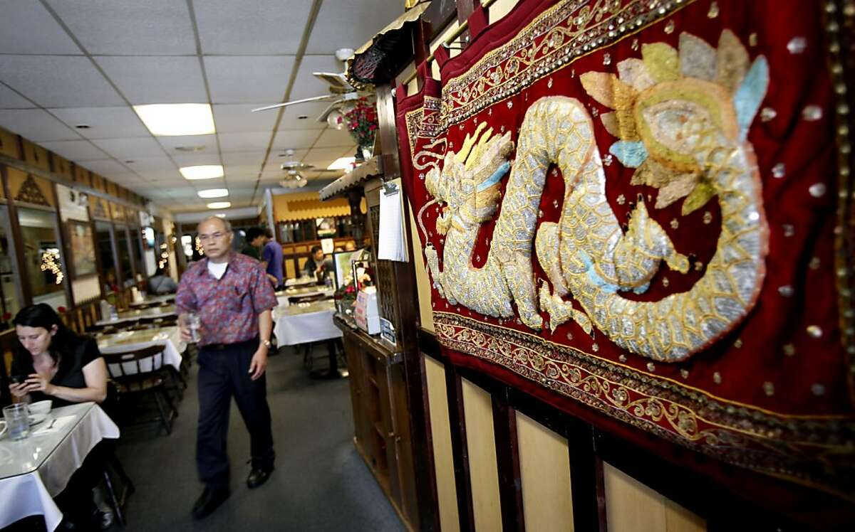 A dragon greets customers at the entrance of Toomie's Thai Cuisine in Alameda, Calif. Thursday, May 31, 2012.