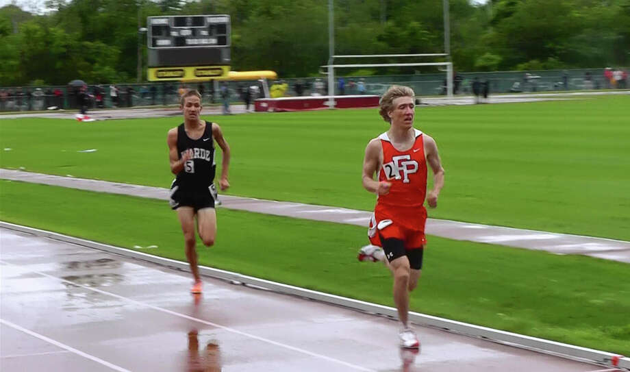 Fairfield Warde's Harry Warnick, left, chases Prep's Connor Rog in the 3,200-meter race at the State Open in New Britain on Monday.Warnick won the race, beating Rog by more than six seconds. Photo: Contributed Photo