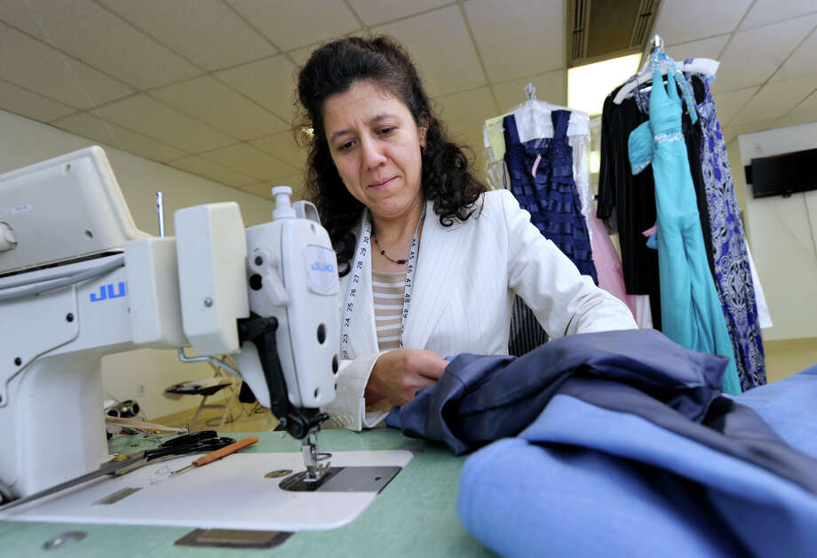 Rosa Cordova, 42, of Danbury, works in her shop, Family Tailor & Cleaners in Gulliver's Plaza on Main Street Danbury, Tuesday, June 5, 2012. Photo: Carol Kaliff