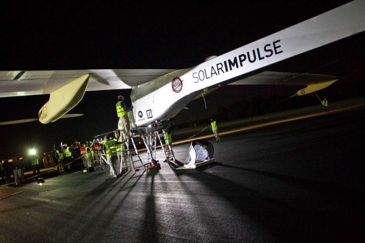 Crew members of Solar Impulse project check the HB-SIA experimental aircraft before taking off at Barajas airport in Madrid, Spain, Tuesday. The solar-powered airplane arrived in Madrid on May 25, 2012, from Payerne, Switzerland, and now goes on to Rabat, Morocco on its first transcontinental trip. The mission is described as the final dress rehearsal for a round-the-world flight with a new and improved aircraft in 2014.