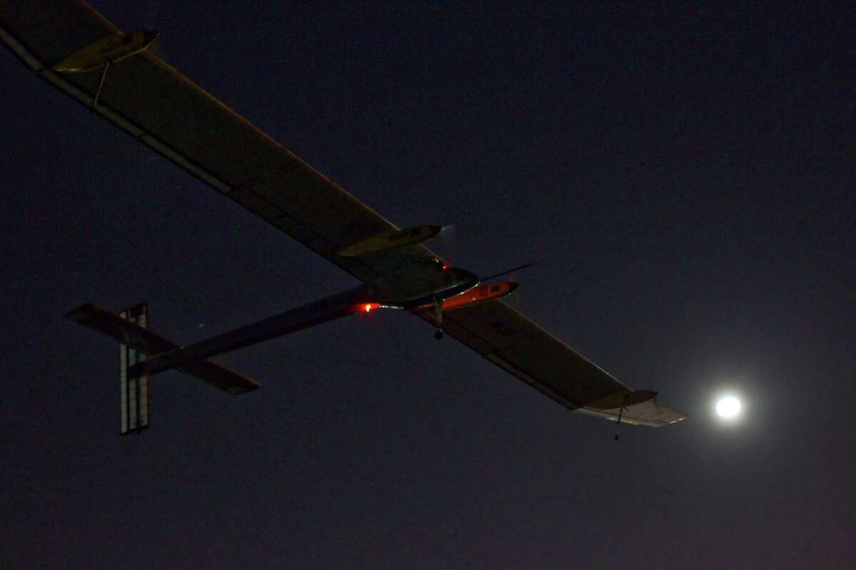 The Solar Impulse HB-SIA experimental aircraft flies after taking off from Barajas airport in Madrid, Spain, in the early hours of Tuesday. The zero-fuel airplane arrived in Madrid on May 25, 2012, from Payerne, Switzerland, and now goes on to Rabat, Morocco on its first transcontinental trip. The mission is described as the final dress rehearsal for a round-the-world flight with a new and improved aircraft in 2014.