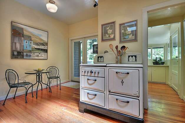 The kitchen is home to the house's original Wedgewood stove. Photo: Patrice Jerome