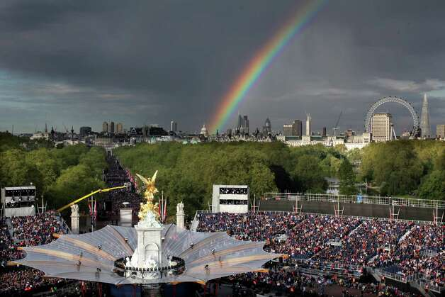 A rainbow is seen over London Eye and the stage of the The Diamond Jubilee Concert outside Buckingham Palace in London, on June 4, 20112. A chain of more than 4,200 beacons began to flare across the globe Monday to mark Queen Elizabeth II's diamond jubilee, with the last to be lit by the monarch at a star-studded concert at Buckingham Palace. AFP PHOTO / DAVID BEBBER /POOL        (Photo credit should read DAVID BEBBER/AFP/GettyImages) Photo: DAVID BEBBER, AFP/Getty Images / 2012 AFP
