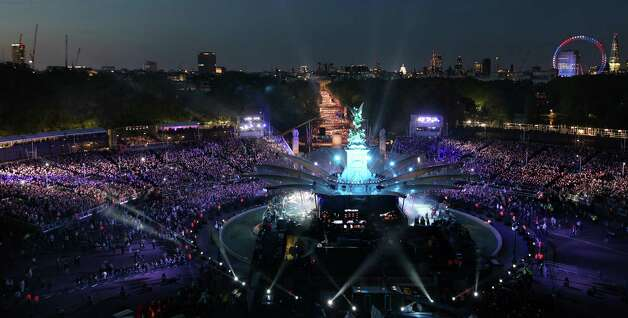 General view shows the stage and spectators of the The Diamond Jubilee Concert outside Buckingham Palace in London, on June 4, 20112. A chain of more than 4,200 beacons began to flare across the globe Monday to mark Queen Elizabeth II's diamond jubilee, with the last to be lit by the monarch at a star-studded concert at Buckingham Palace. AFP PHOTO / DAVID BEBBER /POOL        (Photo credit should read DAVID BEBBER/AFP/GettyImages) Photo: DAVID BEBBER, AFP/Getty Images / 2012 AFP