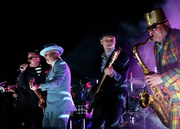 The band Madness perform on the rooftop of Buckingham Palace during The Diamond Jubilee Concert in London, on June 4, 20112. A chain of more than 4,200 beacons began to flare across the globe Monday to mark Queen Elizabeth II's diamond jubilee, with the last to be lit by the monarch at a star-studded concert at Buckingham Palace. AFP PHOTO / DAVID BEBBER /POOL        (Photo credit should read DAVID BEBBER/AFP/GettyImages) Photo: DAVID BEBBER, AFP/Getty Images / 2012 AFP