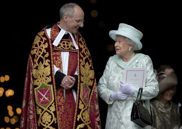 Britain's Queen Elizabeth II (R) talks with Dean of St Paul's David Ison (L) as she leaves Saint Paul's Cathedral after a national service of thanksgiving for the Queen?s Diamond Jubilee in London on June 5, 2012. Britain's Queen Elizabeth II wraps up four days of diamond jubilee celebrations with a thanksgiving service and ceremonial carriage procession in London, a formal contrast to the spectacular pop tribute staged outside Buckingham Palace the day before. AFP PHOTO / BEN STANSALL        (Photo credit should read BEN STANSALL/AFP/GettyImages) Photo: BEN STANSALL, AFP/Getty Images / 2012 AFP