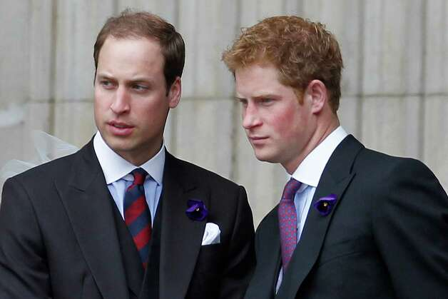 Britain's Prince William (L) and Prince Harry (R) talks as they leave Saint Paul's Cathedral after a national service of thanksgiving for the Queen?s Diamond Jubilee in London on June 5, 2012. Britain's Queen Elizabeth II wraps up four days of diamond jubilee celebrations with a thanksgiving service and ceremonial carriage procession in London, a formal contrast to the spectacular pop tribute staged outside Buckingham Palace the day before. AFP PHOTO / IAN KINGTON        (Photo credit should read IAN KINGTON/AFP/GettyImages) Photo: IAN KINGTON, AFP/Getty Images / 2012 AFP