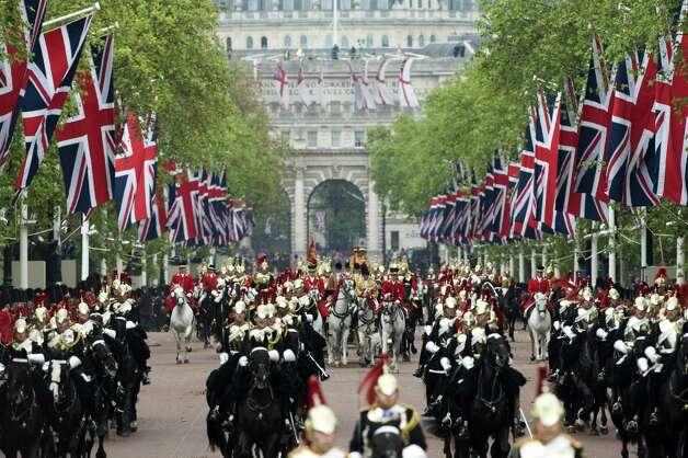 Horses ride down the Mall during the Diamond Jubilee Carriage Procession from Westminster Hall to Buckingham Palace in London on June 5, 2012. Britain's Queen Elizabeth II on wraps up four days of diamond jubilee celebrations and festivities will conclude with a ceremonial carriage procession in London, a formal contrast to the spectacular pop tribute staged outside Buckingham Palace the day before.    AFP PHOTO / JOHN MACDOUGALL        (Photo credit should read JOHN MACDOUGALL/AFP/GettyImages) Photo: JOHN MACDOUGALL, AFP/Getty Images / 2012 AFP