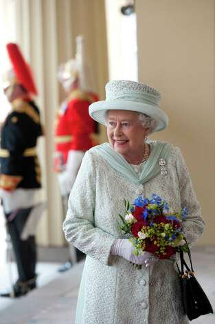 Britain's Queen Elizabeth II arrives at Buckingham Palace at the end of a carriage procession following a national service of thanksgiving in honour of the Queen's Diamond Jubilee in London on June 5, 2012. Queen Elizabeth II attended the final day of celebrations for her diamond jubilee Tuesday, but the pomp and splendour were marred by the absence of her husband Prince Philip after he was hospitalised. AFP PHOTO / CARL COURT        (Photo credit should read CARL COURT/AFP/GettyImages) Photo: CARL COURT, AFP/Getty Images / 2012 AFP