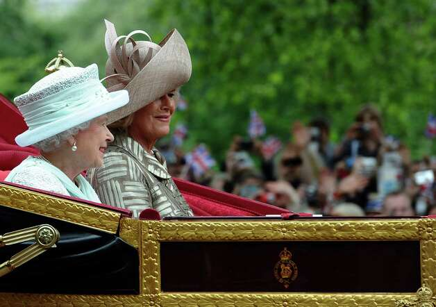 Britain's Queen Elizabeth II (L) and Camilla, Duchess of Cornwall ride in the 1902 State Landau coach during a carriage procession from Westminster Hall to Buckingham Palace after attending a national service of thanksgiving to celebrate the Queen's Diamond Jubilee in London on June 5, 2012. Queen Elizabeth II attended the final day of celebrations for her diamond jubilee Tuesday, but the pomp and splendour were marred by the absence of her husband Prince Philip after he was hospitalised. AFP PHOTO / PAUL ELLIS        (Photo credit should read PAUL ELLIS/AFP/GettyImages) Photo: PAUL ELLIS, AFP/Getty Images / 2012 AFP