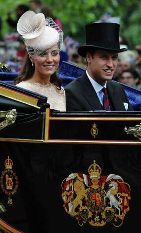 Britain's Catherine, Duchess of Cambridge, and Prince William ride in a State Landau coach during a carriage procession from Westminster Hall to Buckingham Palace after attending a national service of thanksgiving to celebrate the Queen's Diamond Jubilee in London on June 5, 2012. Queen Elizabeth II attended the final day of celebrations for her diamond jubilee Tuesday, but the pomp and splendour were marred by the absence of her husband Prince Philip after he was hospitalised. AFP PHOTO / PAUL ELLIS        (Photo credit should read PAUL ELLIS/AFP/GettyImages) Photo: PAUL ELLIS, AFP/Getty Images / 2012 AFP
