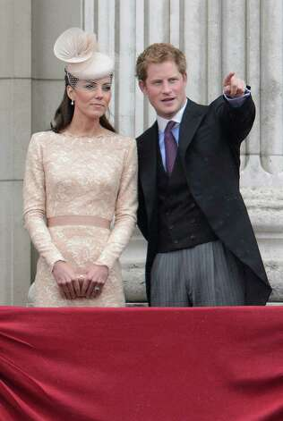 Prince Harry (R) points as Catherine, Duchess of Cambridge (L) follows from the balcony of Buckingham Palace during the flyover of aircraft on the final ceremonial day of the Queens Diamond Jubilee celebrations in London on June 5, 2012. Queen Elizabeth II led a grand carriage procession through London to mark her diamond jubilee Tuesday but faced the crowning moment of the festivities without her ill husband Prince Philip. AFP PHOTO / LEON NEAL        (Photo credit should read LEON NEAL/AFP/GettyImages) Photo: LEON NEAL, AFP/Getty Images / 2012 AFP
