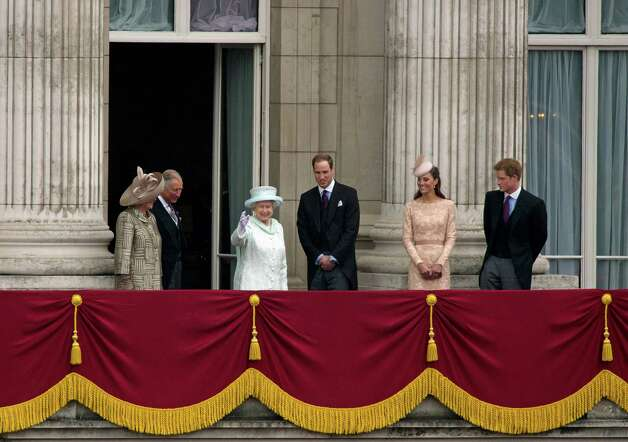 Britain's Queen Elizabeth II, (3rd L) Prince Charles, (2nd L) Camilla, Duchess of Cornwall, (L) Prince Willam, (3rd R) Catherine, Duchess of Cambridge (2nd R) and Prince Harry (R) appear on the Buckingham Palace balcony following the Queen's diamond jubilee procession in London, on June 5, 2012. Queen Elizabeth II's husband Prince Philip, her stalwart companion through 60 years of rule, was absent from her side Tuesday as she marked the final day of her diamond jubilee with traditional pomp.   AFP PHOTO / ADRIAN DENNIS        (Photo credit should read ADRIAN DENNIS/AFP/GettyImages) Photo: ADRIAN DENNIS, AFP/Getty Images / 2012 AFP