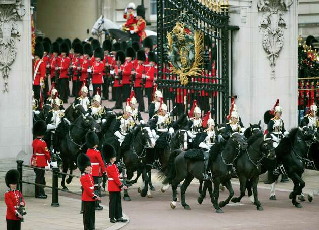 British Household Cavalry ride through the gates of Buckingham Palace at the end of the royal carriage procession from Westminster Hall on the final ceremonial day of celebrations for the Queen's Diamond Jubilee in London on June 5, 2012. Queen Elizabeth II led a grand carriage procession through London to mark her diamond jubilee Tuesday but faced the crowning moment of the festivities without her ill husband Prince Philip. AFP PHOTO / ADRIAN DENNIS        (Photo credit should read ADRIAN DENNIS/AFP/GettyImages) Photo: ADRIAN DENNIS, AFP/Getty Images / 2012 AFP