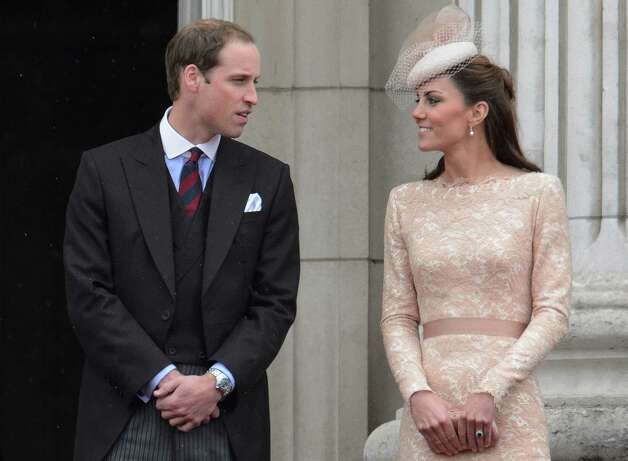 Prince William (L) and Catherine, Duchess of Cambridge (R) look at each other on the balcony of Buckingham Palace on the final ceremonial day of the Queens Diamond Jubilee celebrations in London on June 5, 2012. Queen Elizabeth II led a grand carriage procession through London to mark her diamond jubilee Tuesday but faced the crowning moment of the festivities without her ill husband Prince Philip. AFP PHOTO / LEON NEAL        (Photo credit should read LEON NEAL/AFP/GettyImages) Photo: LEON NEAL, AFP/Getty Images / 2012 AFP