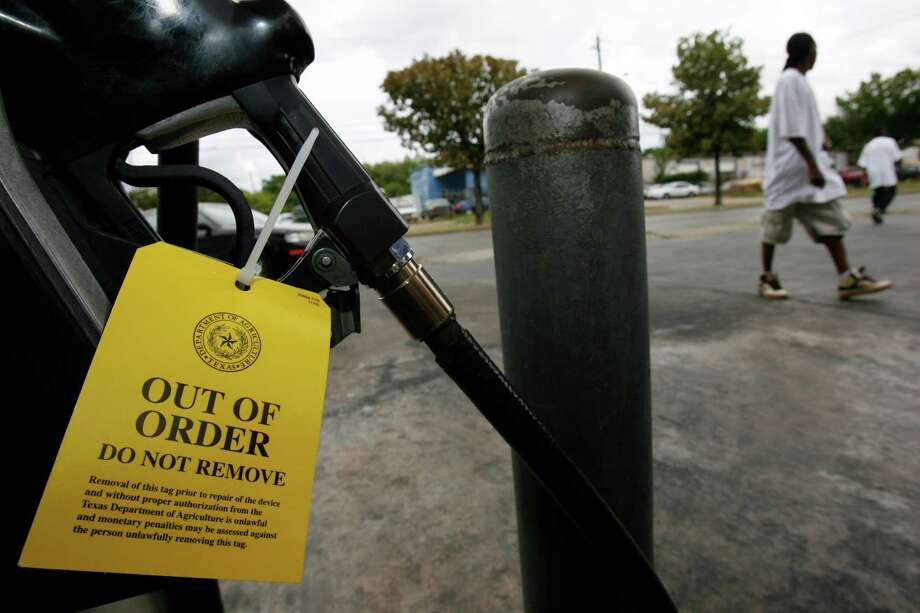 In a year, one faulty pump can cost drivers thousands of dollars. Photo: File Photo, Associated Press / Houston Chronicle Rev-Share