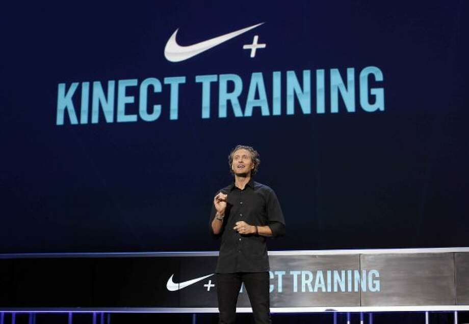 COMMERCIAL IMAGE - In this image provided by Xbox - Stefan Olander, vice president of Digital Sport at Nike, announces Nike + Kinect Training at the Xbox 360 E3 media briefing Monday June 4, 2012 in Los Angeles. (Photo by Joe Kohen/Invision for Xbox) (Invision for Xbox)