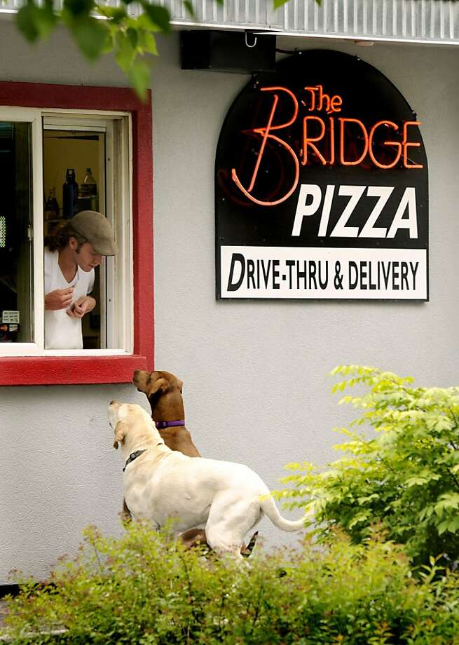 One pepperoni and Snausage, please: You know these two are ordering the Meat Lovers Special. (Missoula, Mont.) Photo: Kurt Wilson, Associated Press
