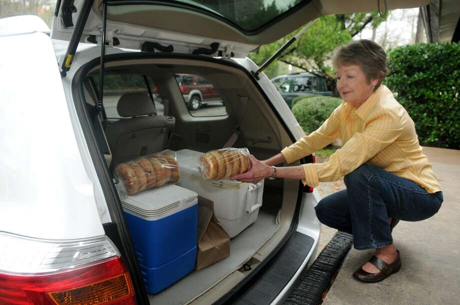 Sherry Blattel, of The Woodands and a Meals on Wheels volunteer, loads up for a delivery at The Woodlands Community Center. Freelance photo by Jerry Baker Photo: Jerry Baker