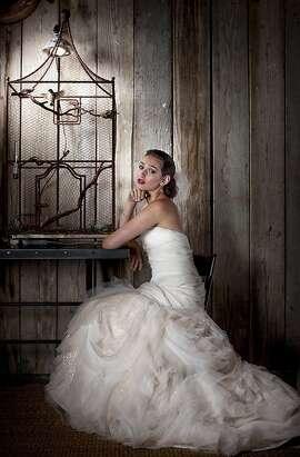 Vera Wang tulle mermaid gown, $6,500, Bridal Galleria, 3 Embarcadero Center, S.F.; Olivia Collings crystal drop earrings, $4,215, Barneys New York, S.F.; Tiffany diamond bangle, $10,500, Tiffany & Co., S.F.; Sara Gabriel Drew veil, $450, www.saragabriel.com.