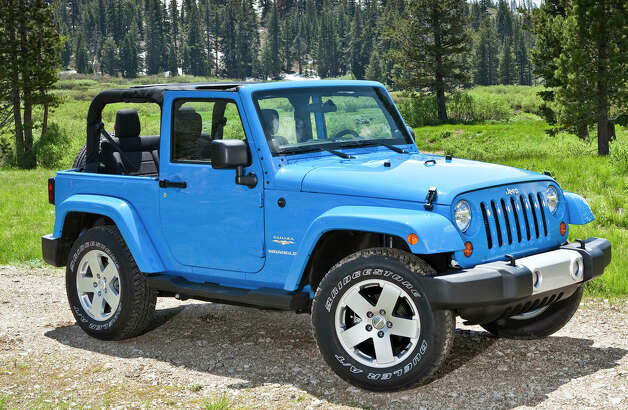 The 2012 Jeep Wrangler is the most refined Wrangler model yet. For 2012, it comes with a new, more powerful and more efficient V-6 engine. Photo: Chrysler Group LLC