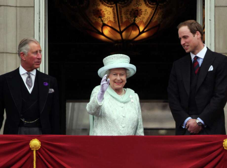 LONDON, ENGLAND - JUNE 05:   Prince Charles, Prince of Wales, Queen Elizabeth II and Prince William, Duke of Cambridge wave to the crowds from Buckingham Palace during the Diamond Jubilee carriage procession after the service of thanksgiving at St.Paulâ??s Cathedral on the Mall on June 5, 2012 in London, England. For only the second time in its history the UK celebrates the Diamond Jubilee of a monarch. Her Majesty Queen Elizabeth II celebrates the 60th anniversary of her ascension to the throne. Thousands of wellwishers from around the world have flocked to London to witness the spectacle of the weekend's celebrations.  (Photo by Dan Kitwood/Getty Images) Photo: Dan Kitwood / 2012 Getty Images