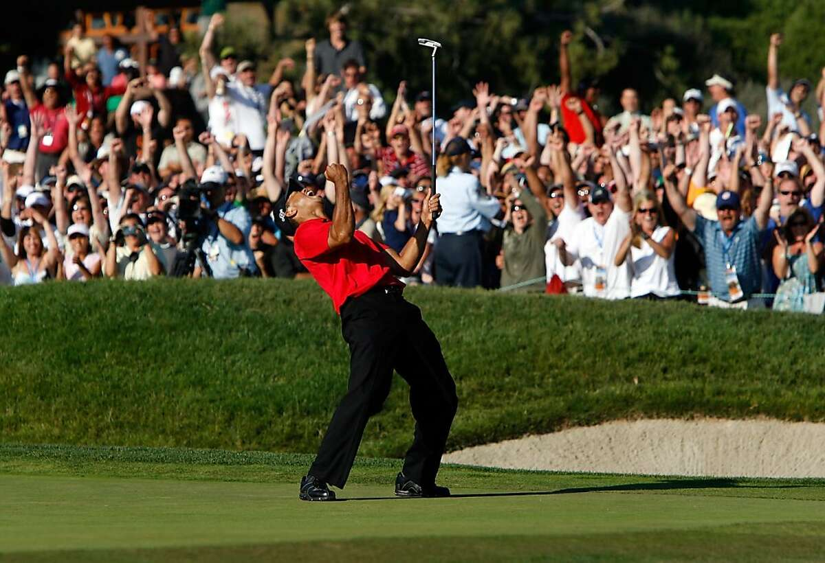 SAN DIEGO - JUNE 15: Tiger Woods reacts to his birdie putt on the 18th green to force a playoff with Rocco Mediate during the final round of the 108th U.S. Open at the Torrey Pines Golf Course (South Course) on June 15, 2008 in San Diego, California. (Photo by Jeff Gross/Getty Images)