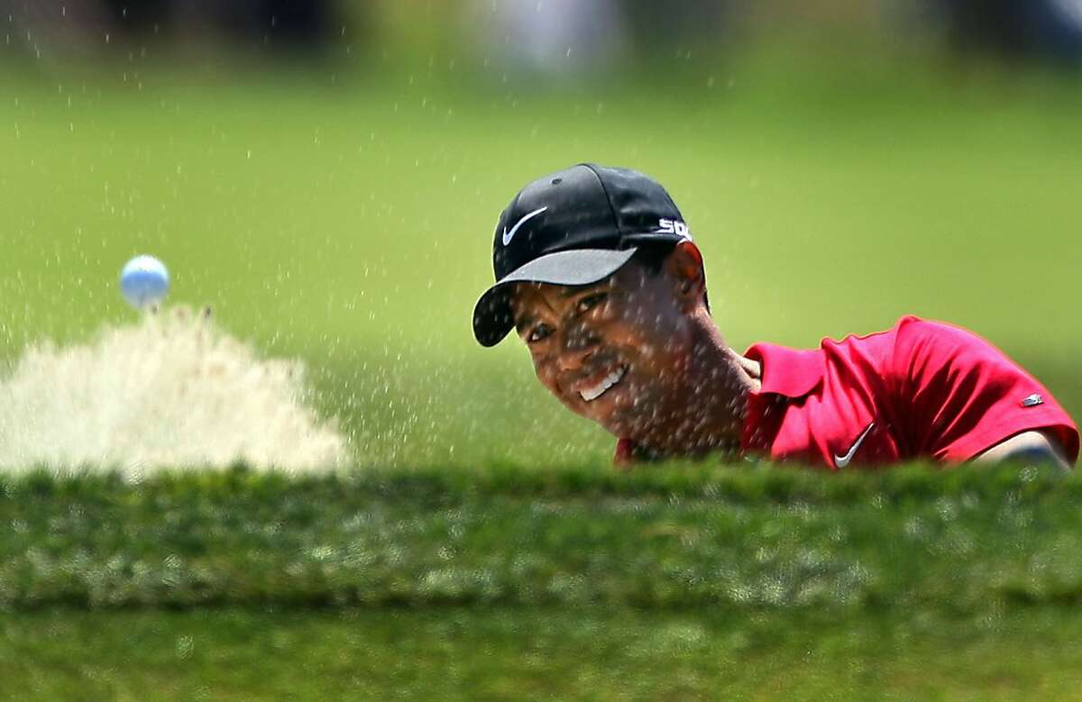 SAN DIEGO - JUNE 15: Tiger Woods hits out of a bunker on the seventh hole during the final round of the 108th U.S. Open at the Torrey Pines Golf Course (South Course) on June 15, 2008 in San Diego, California. (Photo by Donald Miralle/Getty Images)