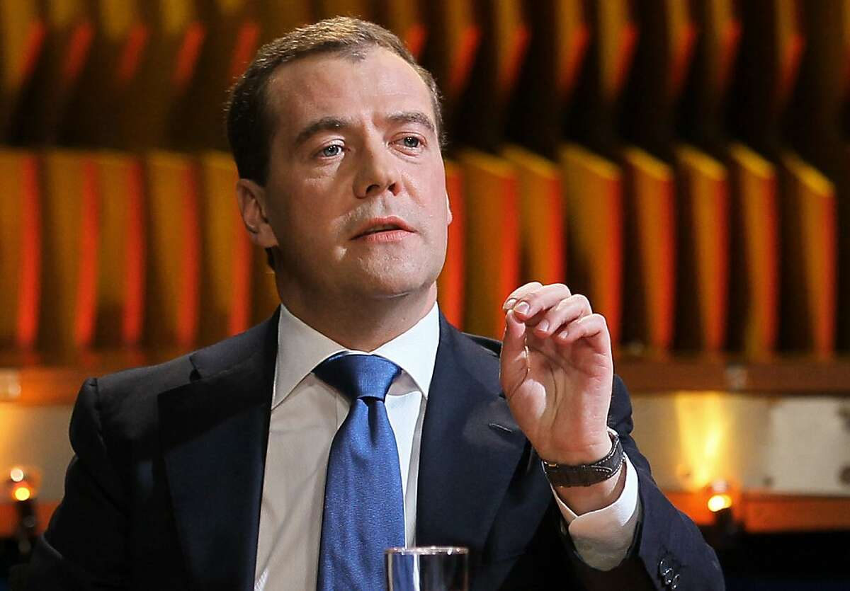 """Prime Minister Dmitry Medvedev answers to a question during an interview with Vladimir Pozner, unseen, on Russian TV Channel One in Moscow, Russia, on Monday, June 4, 2012. Medvedev confirmed that the absence of members of the so-called """"non-system"""" opposition on television is a result of the fact that federal channels do not invite them. (AP Photo/RIA-Novosti, Yekaterina Shtukina, Government Press Service, Pool)"""